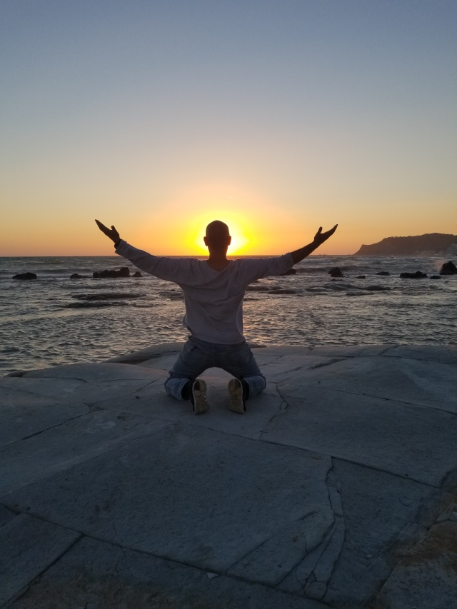 Saluting Father Sun while in Scala dei Turchi, Sicily, Italy